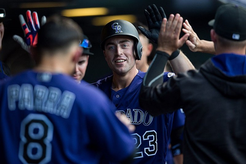 Tom Murphy #23 of the Colorado Rockies celebrates after hitting a seventh inning solo homerun off of Patrick Corbin #46 of the Arizona Diamondbacks at Coors Field on September 4, 2016 in Denver, Colorado.