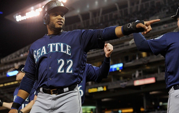 Robinson Cano of the Seattle Mariners celebrates scoring a run against the Minnesota Twins.