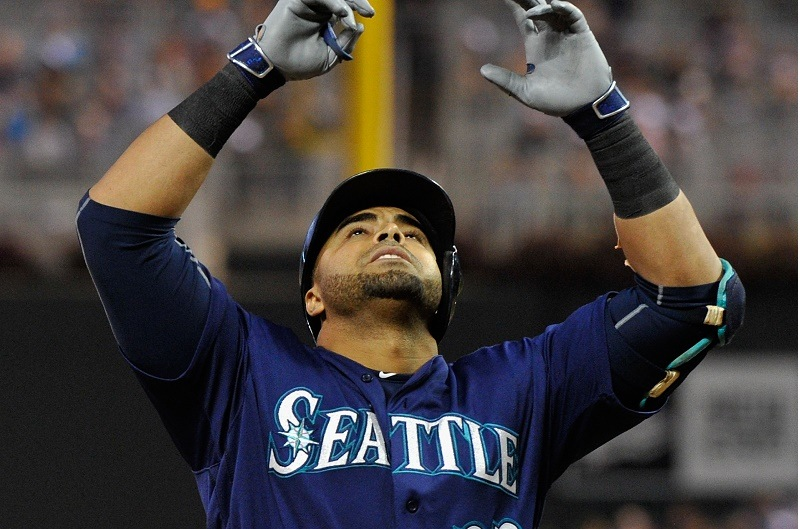 MINNEAPOLIS, MN - SEPTEMBER 24: Nelson Cruz #23 of the Seattle Mariners celebrates hitting a two-run home run against the Minnesota Twins during the fourth inning of the game on September 24, 2016 at Target Field in Minneapolis, Minnesota.