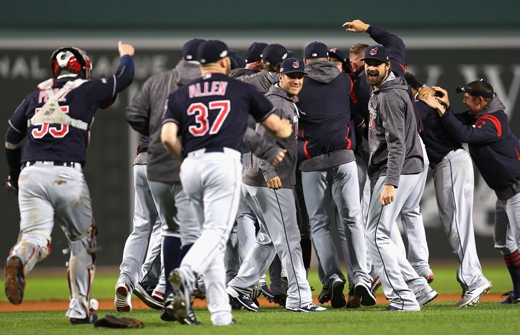 The Cleveland Indians celebrate defeating the Boston Red Sox 4-3 in game three of the American League Divison Series to advance to the American League Championship Series at Fenway Park on October 10, 2016 in Boston, Massachusetts.