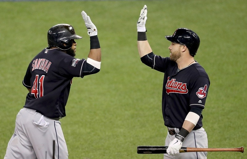 TORONTO, ON - OCTOBER 19: Carlos Santana #41 of the Cleveland Indians celebrates with teammate Jason Kipnis #22 after hitting a solo home run in the third inning against Marco Estrada #25 of the Toronto Blue Jays during game five of the American League Championship Series at Rogers Centre on October 19, 2016 in Toronto, Canada. (Photo by Tom Szczerbowski/Getty Images)