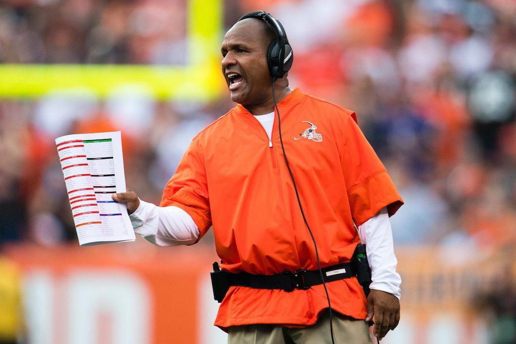 Hue Jackson yells instructions at his players.