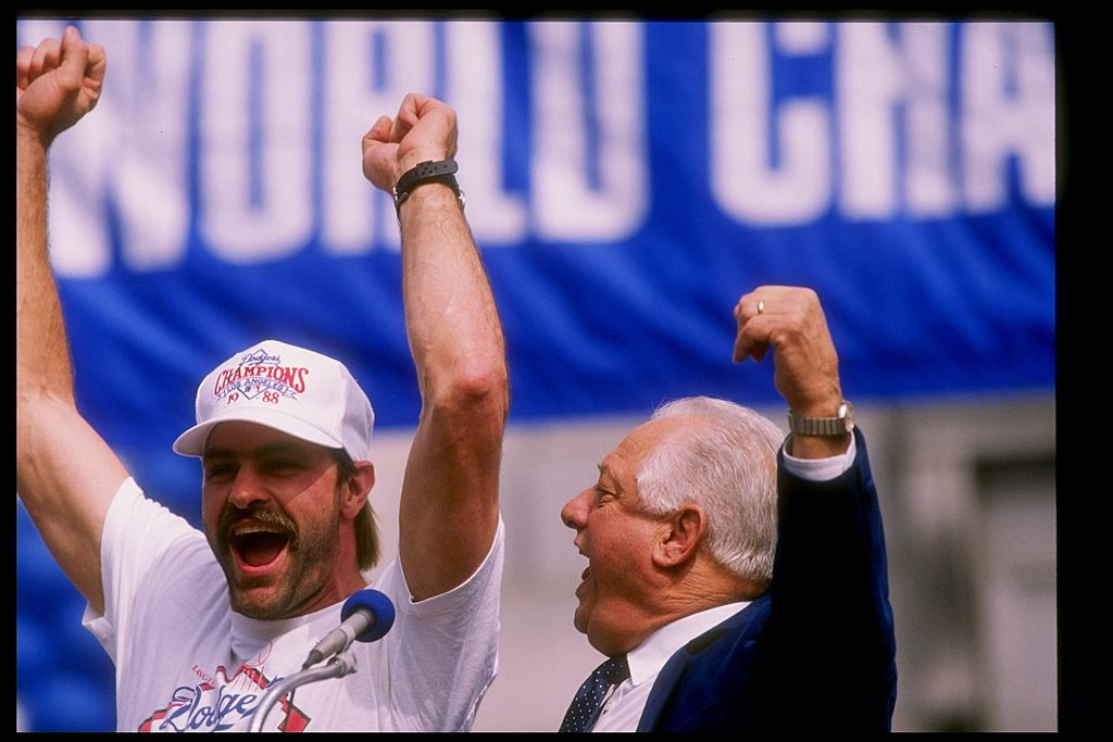 Outfielder Kirk Gibson #23 and manager Tommy Lasorda #2 of the Los Angeles Dodgers speak to the crowd at the Victory Parade for the Los Angeles Dodgers. The Dodgers were the World Series winner that year.
