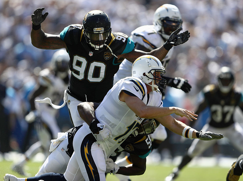 Malik Jackson #90 and Dante Fowler #56 of the Jacksonville Jaguars bring down Philip Rivers #17 of the San Diego Chargers at Qualcomm Stadium on September 18, 2016 in San Diego, California. (Photo by Sean M. Haffey/Getty Images)