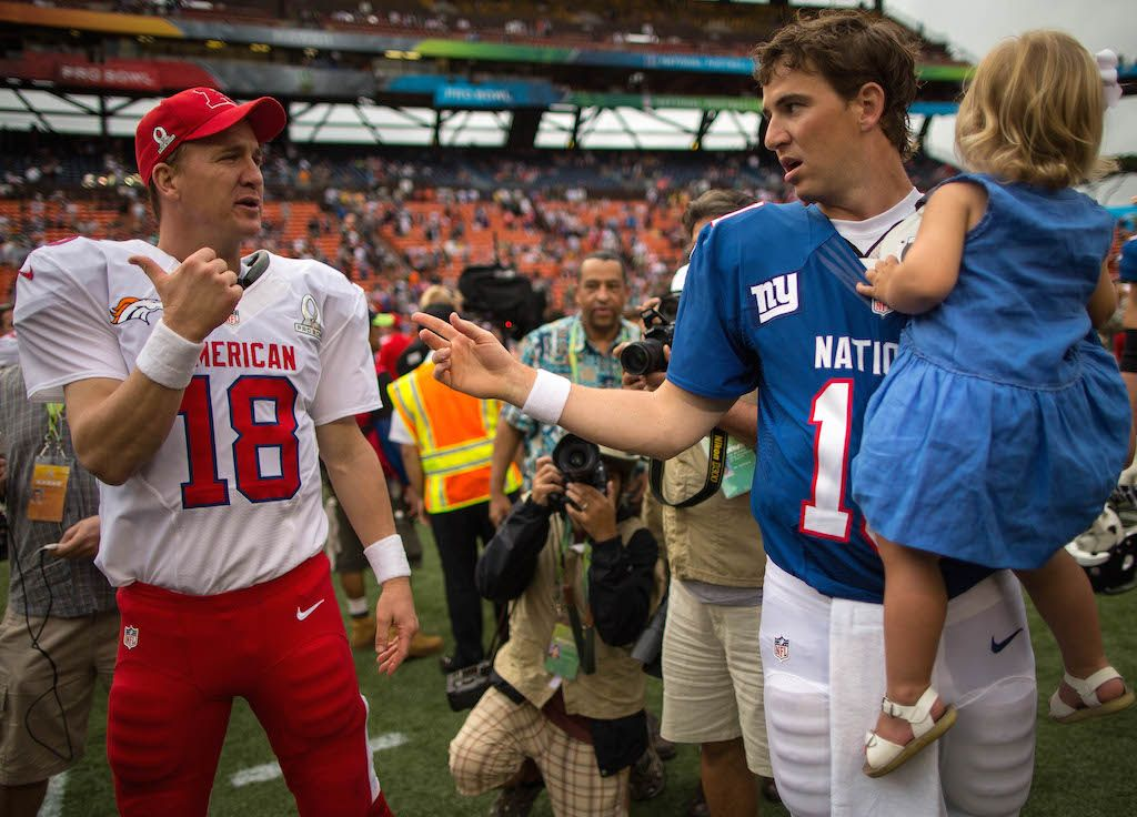 Peyton Manning and Eli Manning both know a thing or two about Pro Bowls | Kent Nishimura/Getty Images