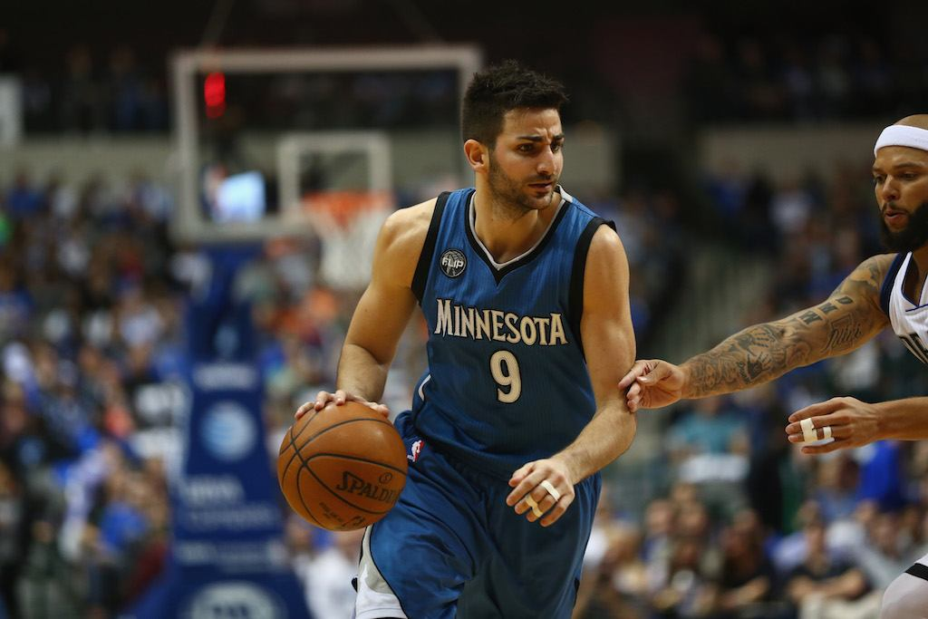 Ricky Rubio defends the ball against a member of the opposing team
