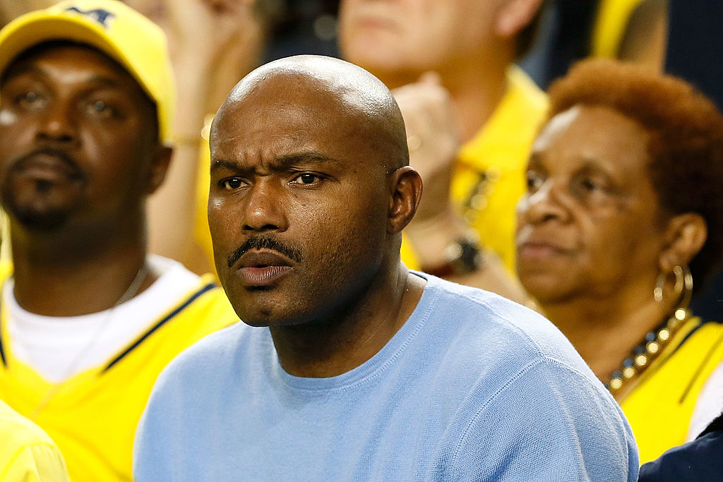 Tim Hardaway Sr., father of Tim Hardaway Jr. of the Michigan Wolverines, watches the action.