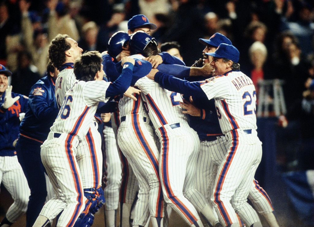 The 1986 New York Mets team celebrates its victory over the Boston Red Sox in the World Series.