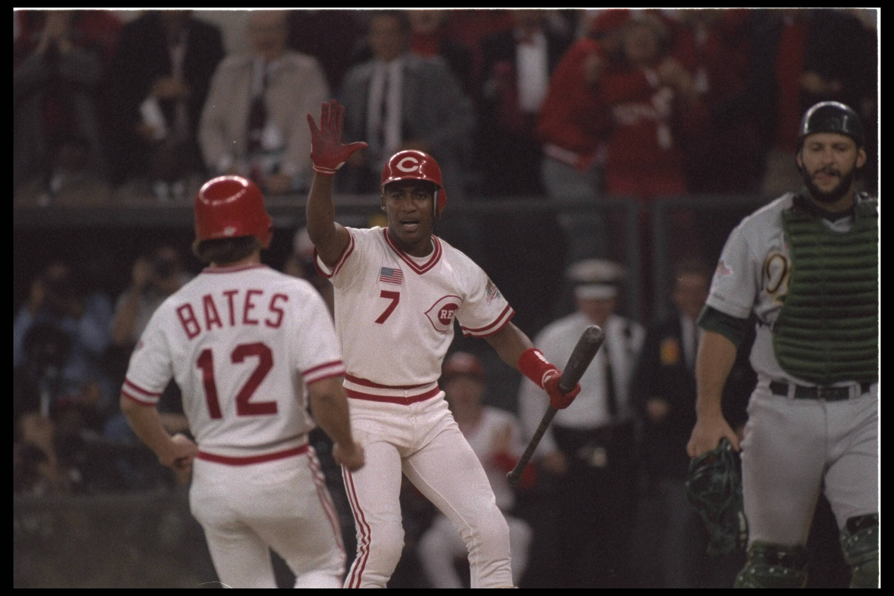#7 and #12 Bates of the Cincinnati Reds celebrate becoming the World Series winner