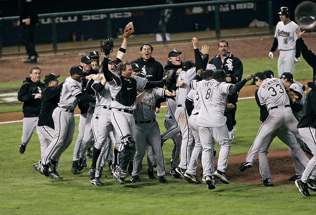 Members of the Chicago White Sox celebrate on the field after winning the 2005 World Series