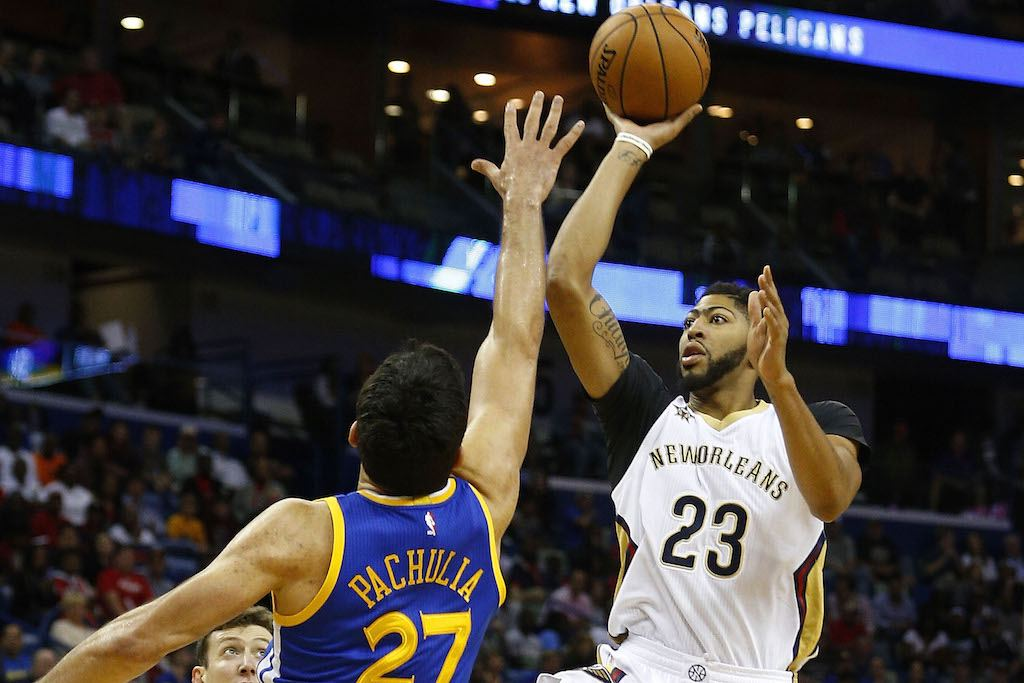 Anthony Davis of the New Orleans pelicans sails over Zaza pachulia, formerly of the Golden State Warriors.