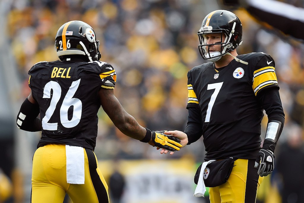 LeVeon Bell and Big Ben give each other a low five.