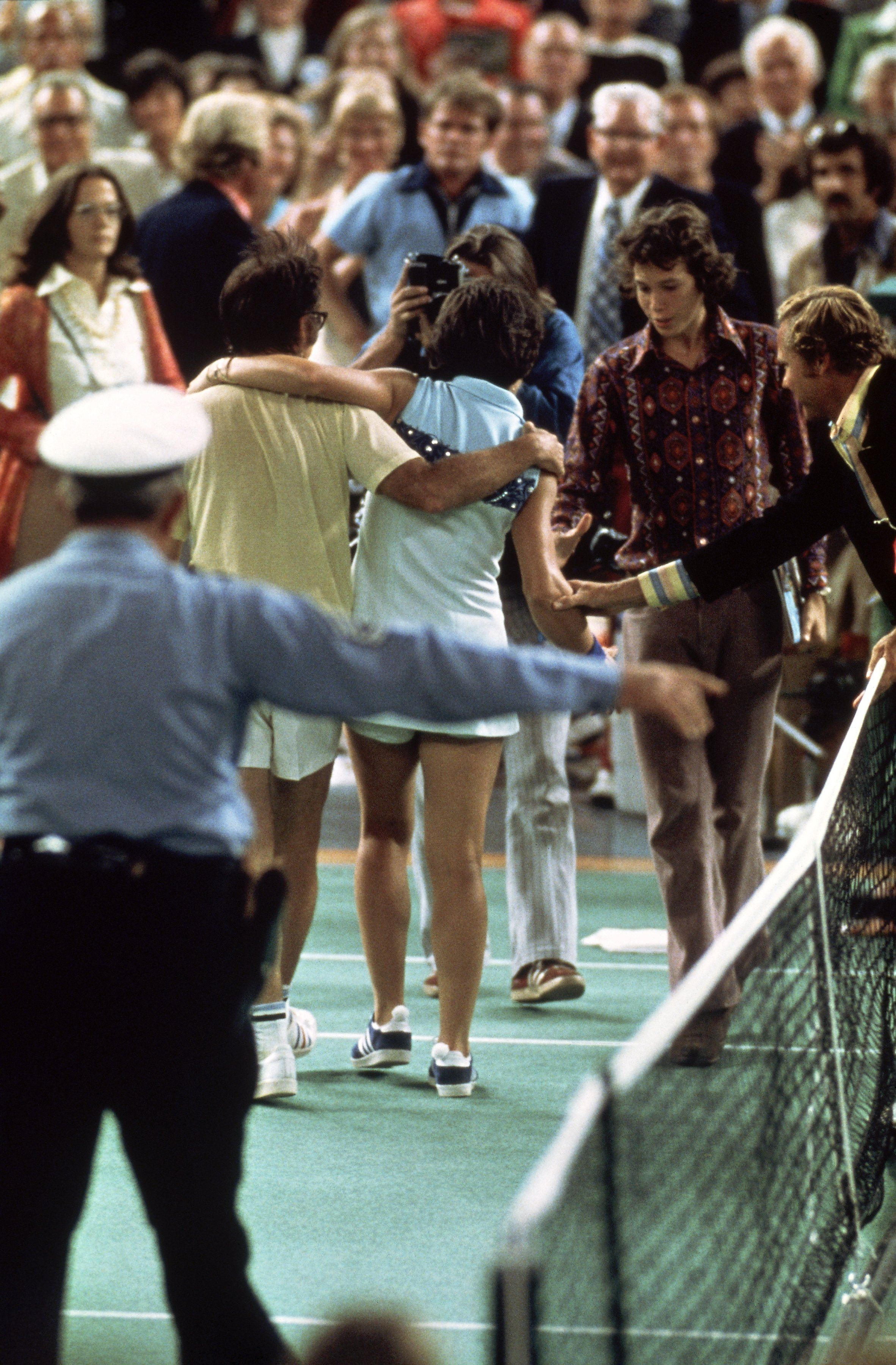 Bobby Riggs of the USA comes off court defeated by Billie Jean-King of the USA