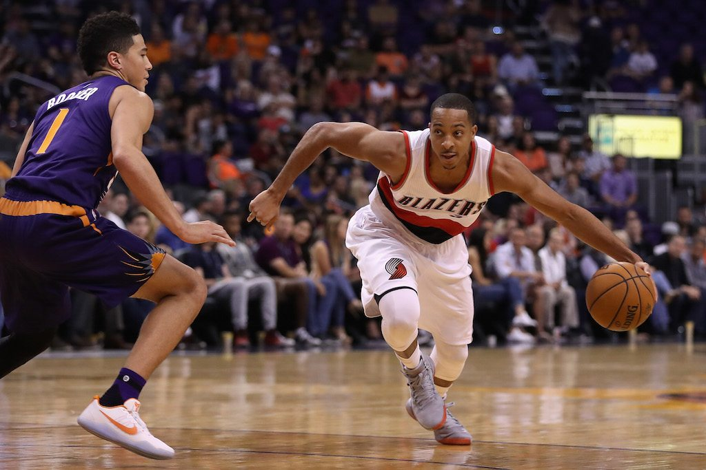 Portland's C.J. McCollum dribbles toward the basket.