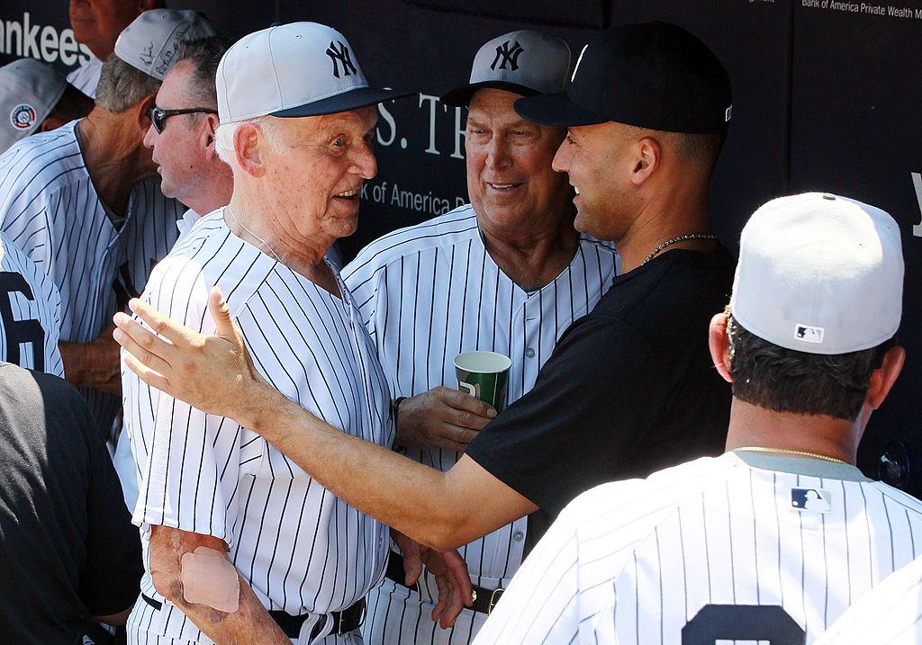 Derek Jeter #2 of the New York Yankees talks with former Yankee Don Larsen