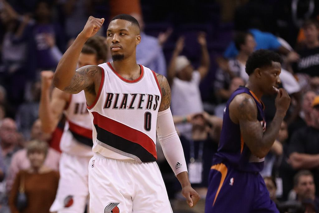 Damian Lillard fist pumps after scoring.