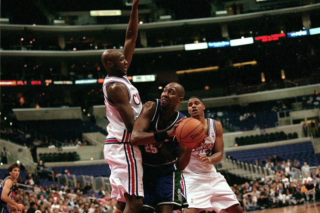 Danny Manning of the Milwaukee Bucks leans to pass the ball during a game against the Los Angeles Clippers.