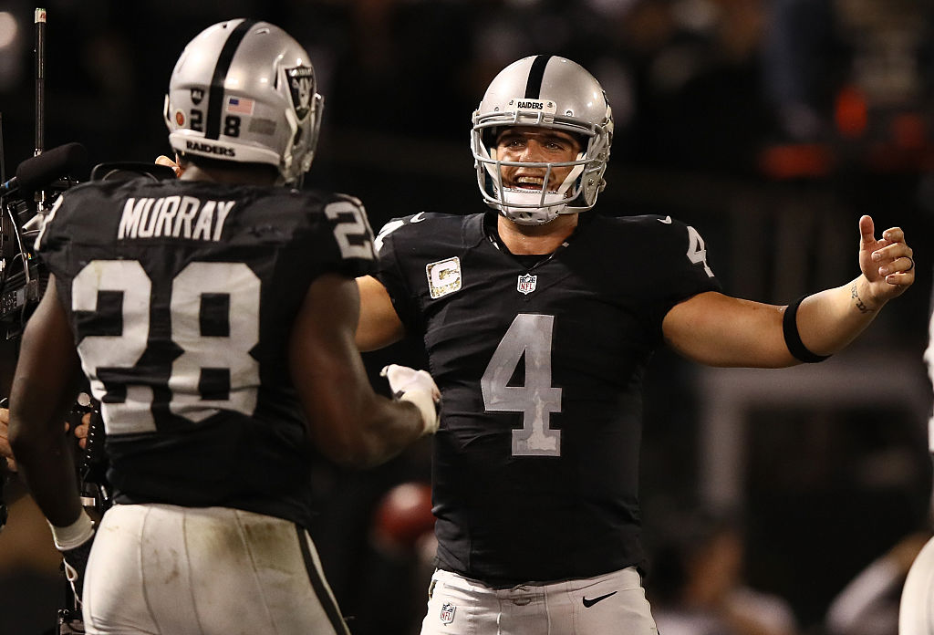 Derek Carr (R) of the Oakland Raiders and Latavius Murray celebrate after a touchdown