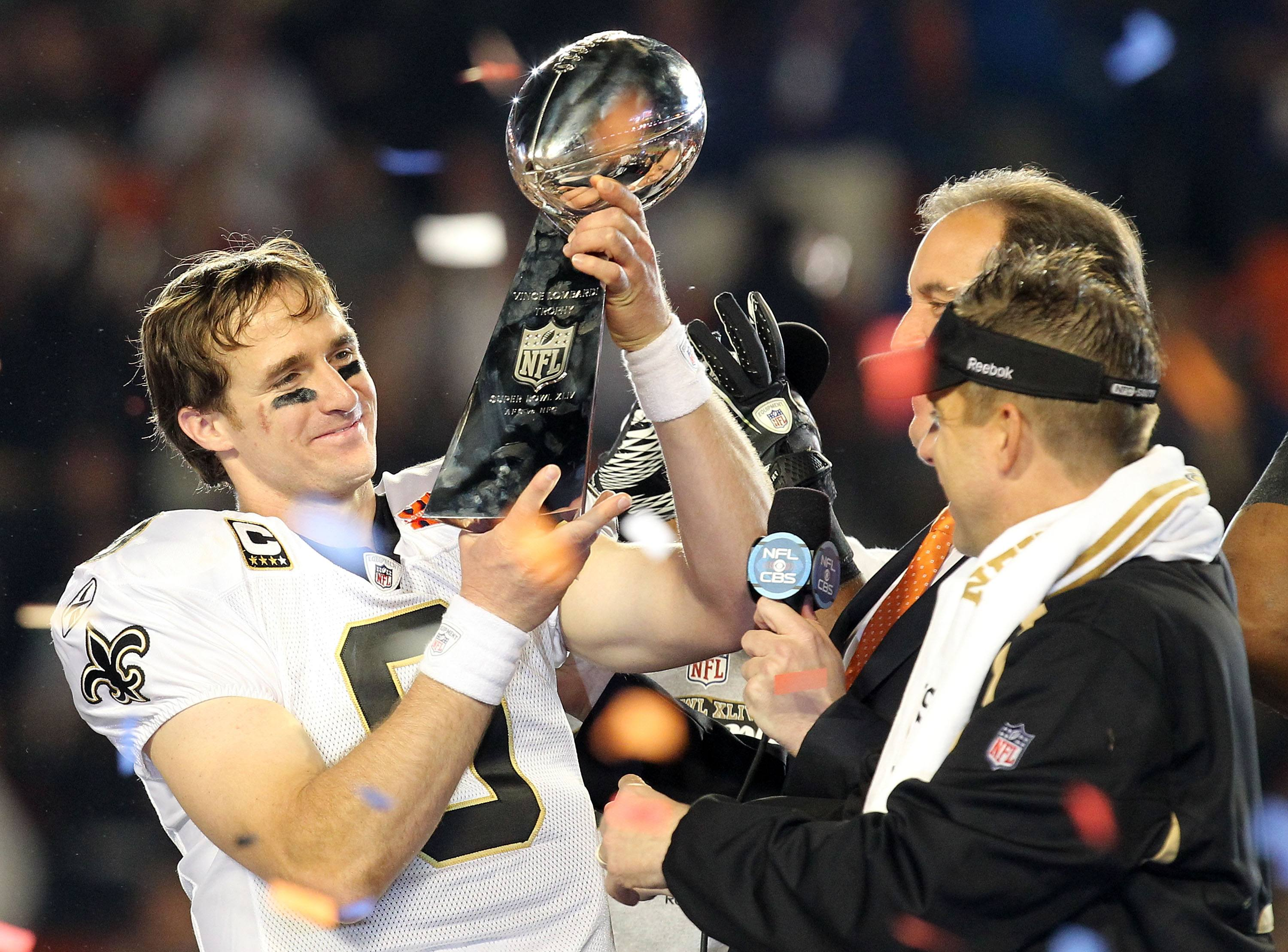 Drew Brees holds the Super Bowl trophy