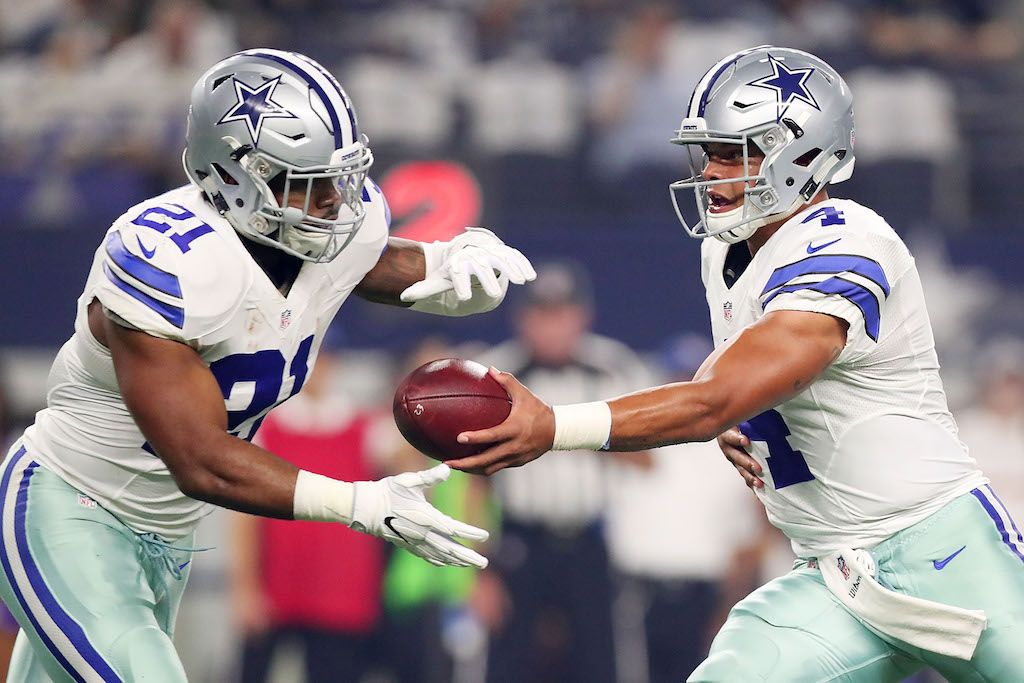 Dak Prescott #4 of the Dallas Cowboys hands the ball off to Ezekiel Elliott #21.