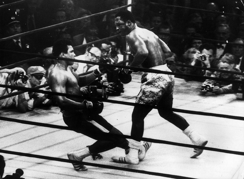 In a title fight at Madison Square Gardens, New York, Muhammad Ali goes down in the 15th round