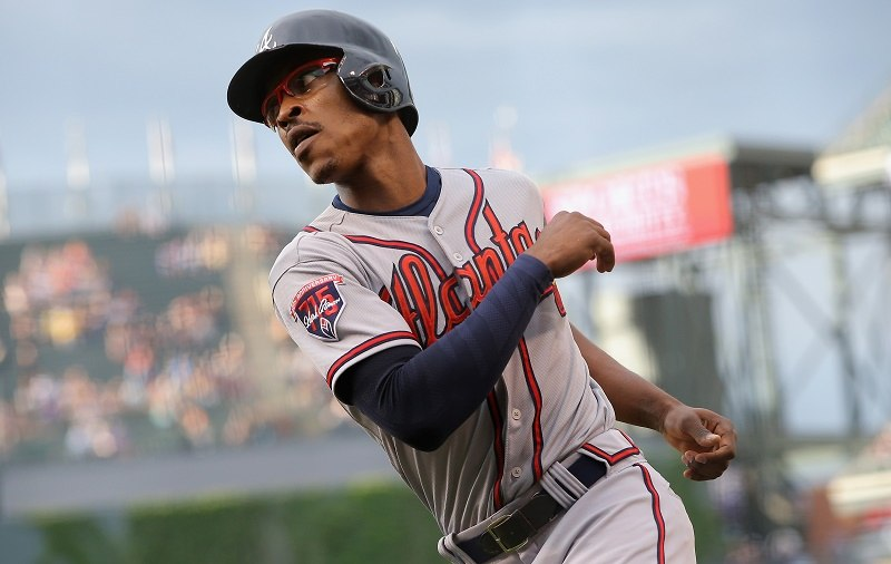 Upton of the Atlanta Braves scores in the first inning against the Colorado Rockies