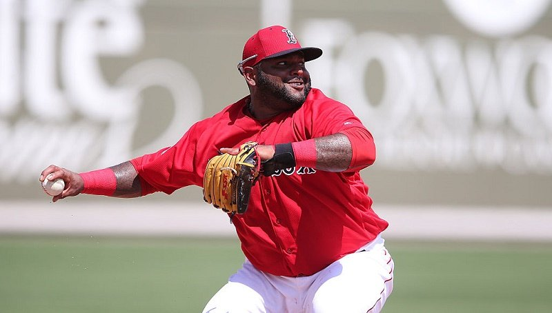 Pablo Sandoval of the Boston Red Sox makes the throw to first