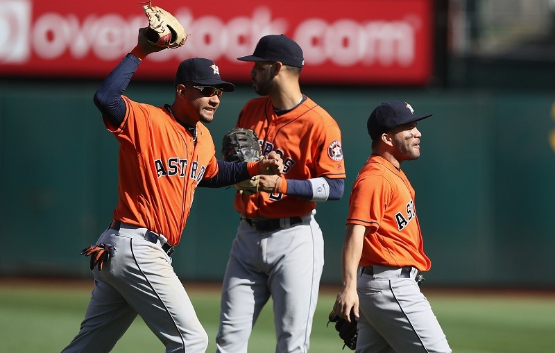 Yulieski Gurriel and Jose Altuve of the Houston Astros celebrate after they beat the Oakland Athletics.