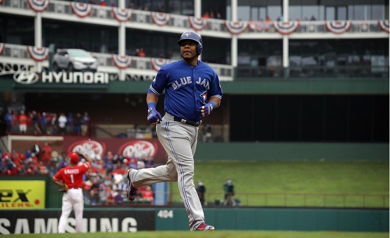 Edwin Encarnacion of the Toronto Blue Jays runs onto the field.