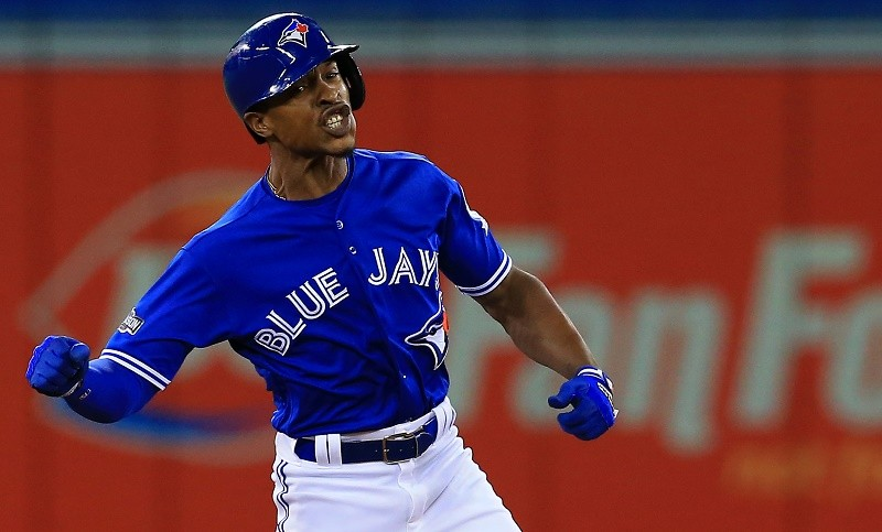 Melvin Upton Jr. of the Toronto Blue Jays celebrates after hitting a double against the Texas Rangers in the sixth inning during game three of the American League Division Series at Rogers Centre