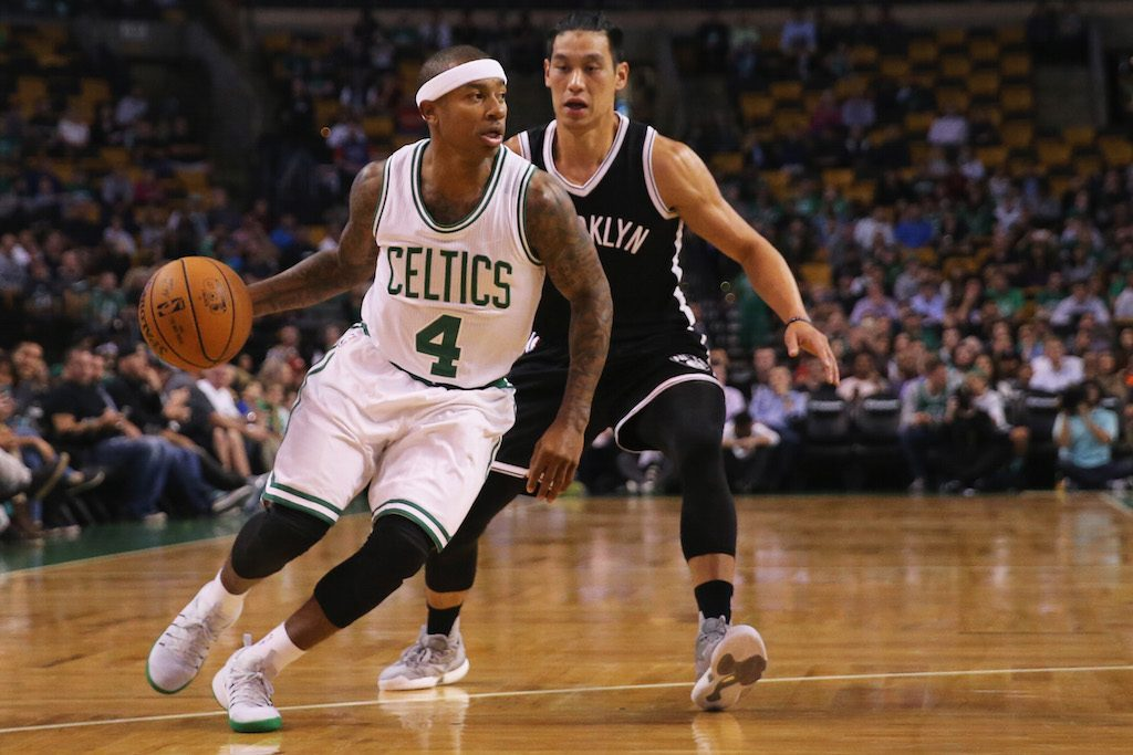Isaiah Thomas rushes past a Brooklyn Nets guard