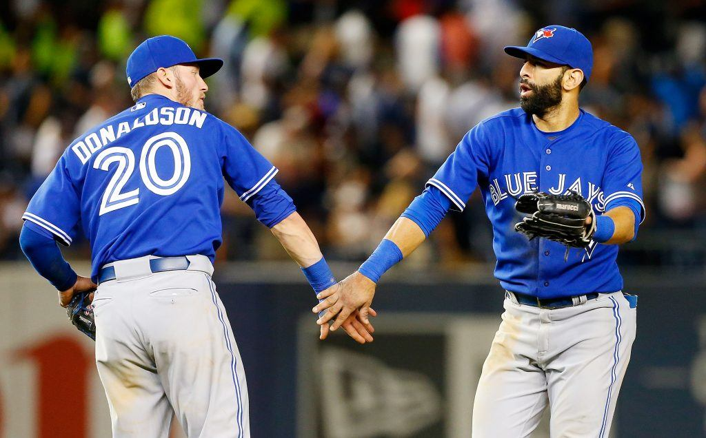 Josh Donaldson and Edwin Encarnacion low five.