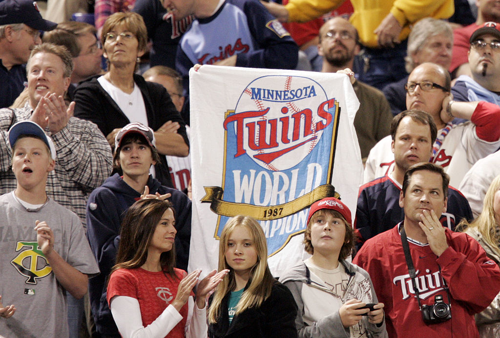 A Minnesota Twins fan holds up a sign honoring the 1987 World Series winners
