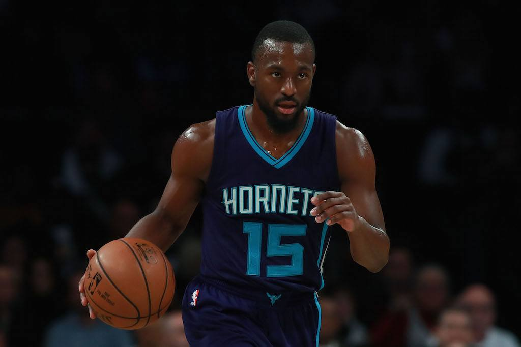 Kemba Walker dribbles toward the basket.