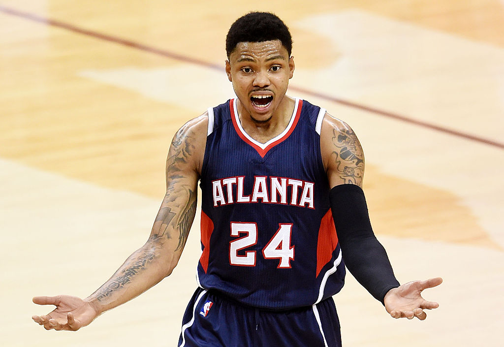 Kent Bazemore of the Atlanta Hawks reacts after being called for a foul.