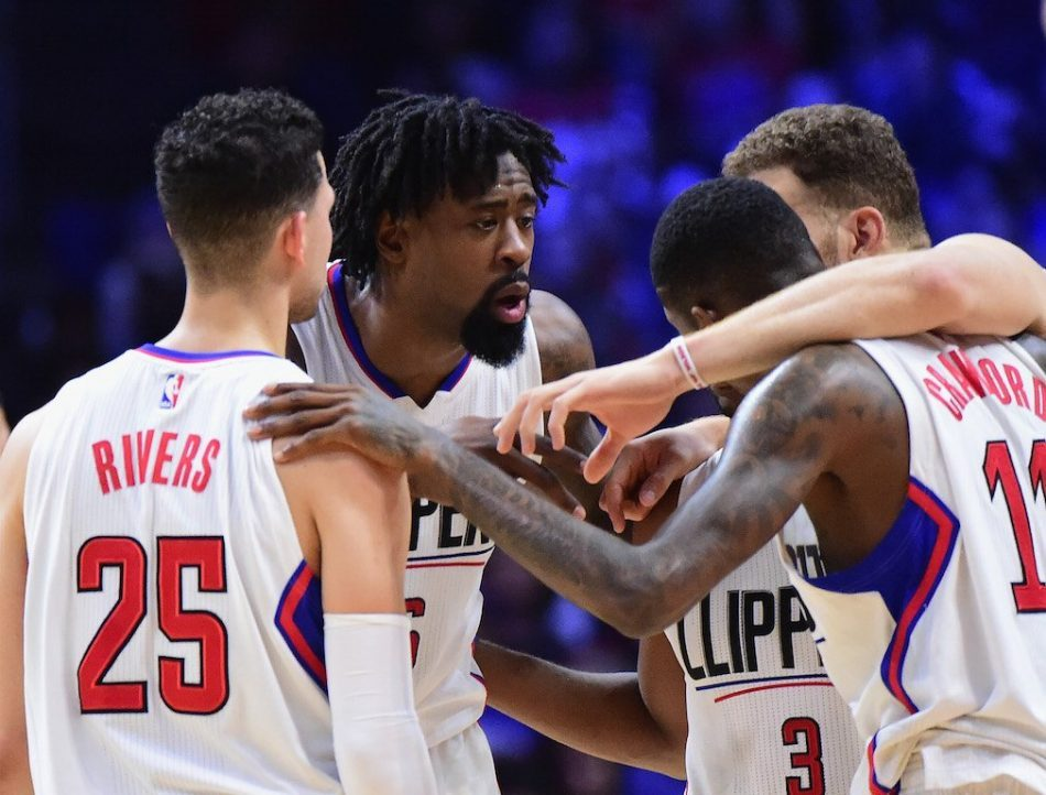 The LA Clippers huddle together and demonstrate their teamwork.