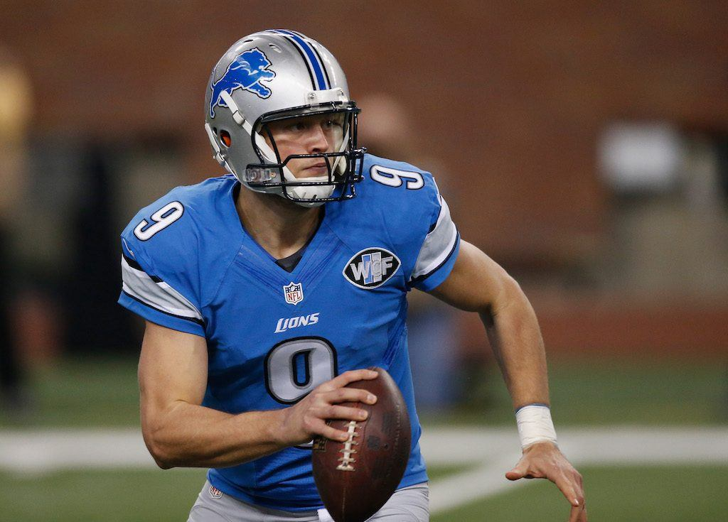 Matthew Stafford grips the football as he looks for a target.