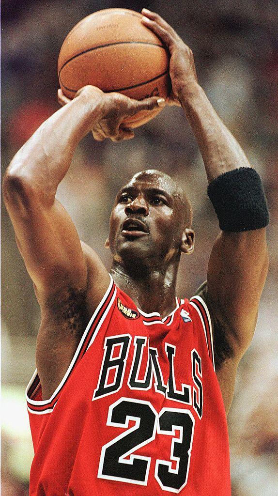 Michael Jordan of the Chicago Bulls takes a shot against the Utah Jazz