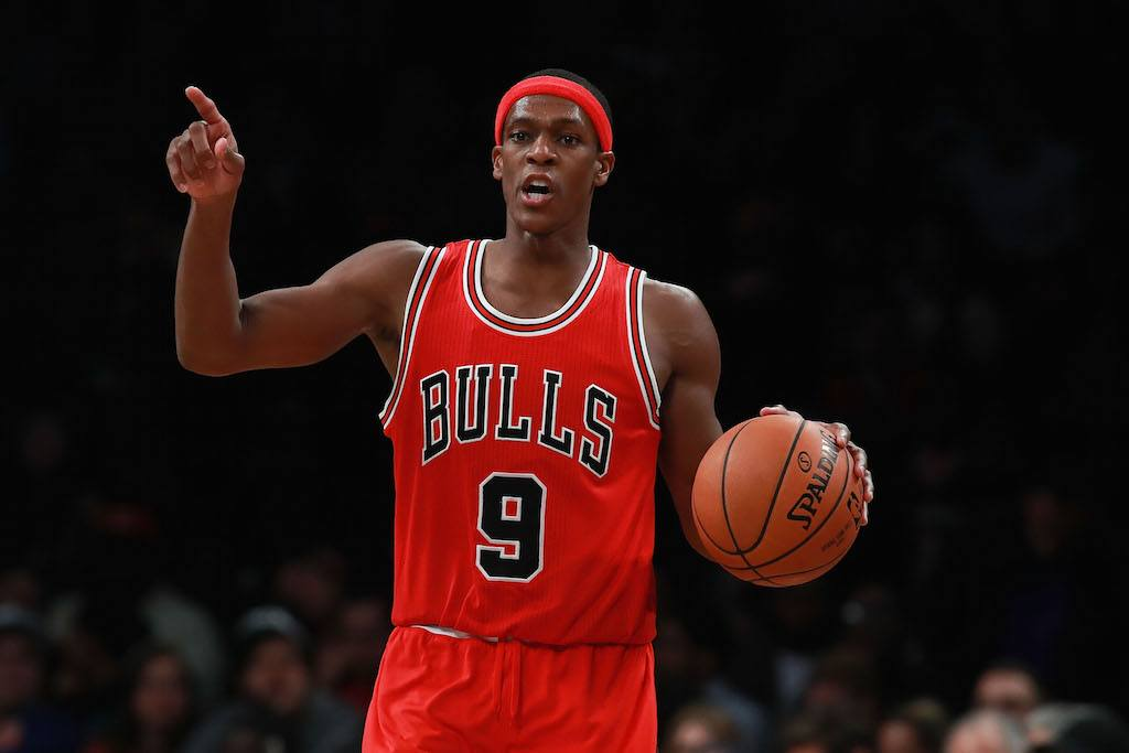 Rajon Rondo points at the referee.