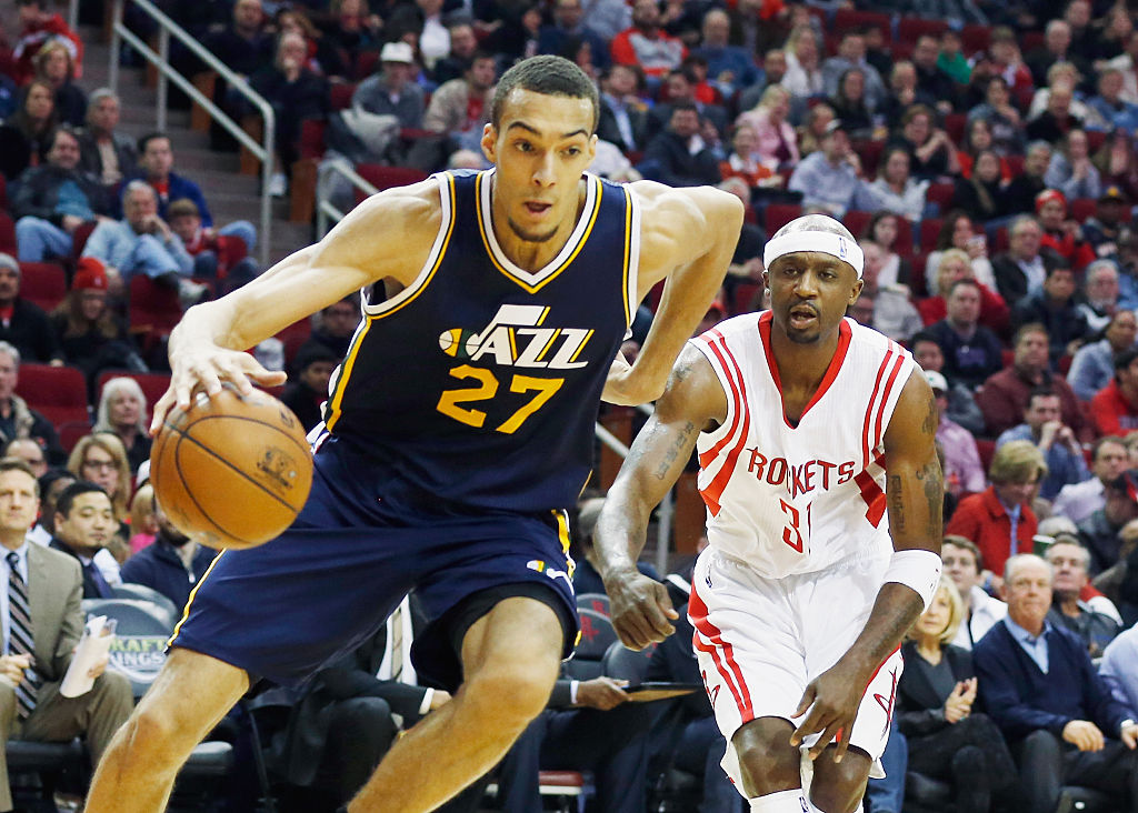 Rudy Gobert of the Utah Jazz drives with the basketball in front of Jason Terry of the Houston Rockets