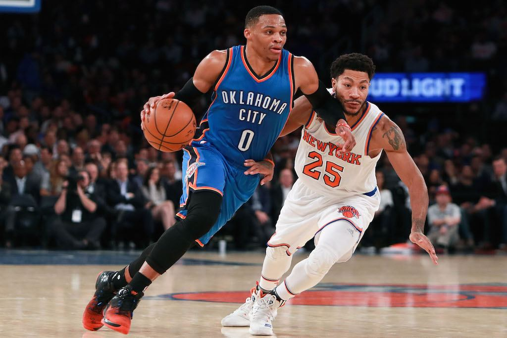 Russell Westbrook blows by a New York Knicks player on the way to the basket