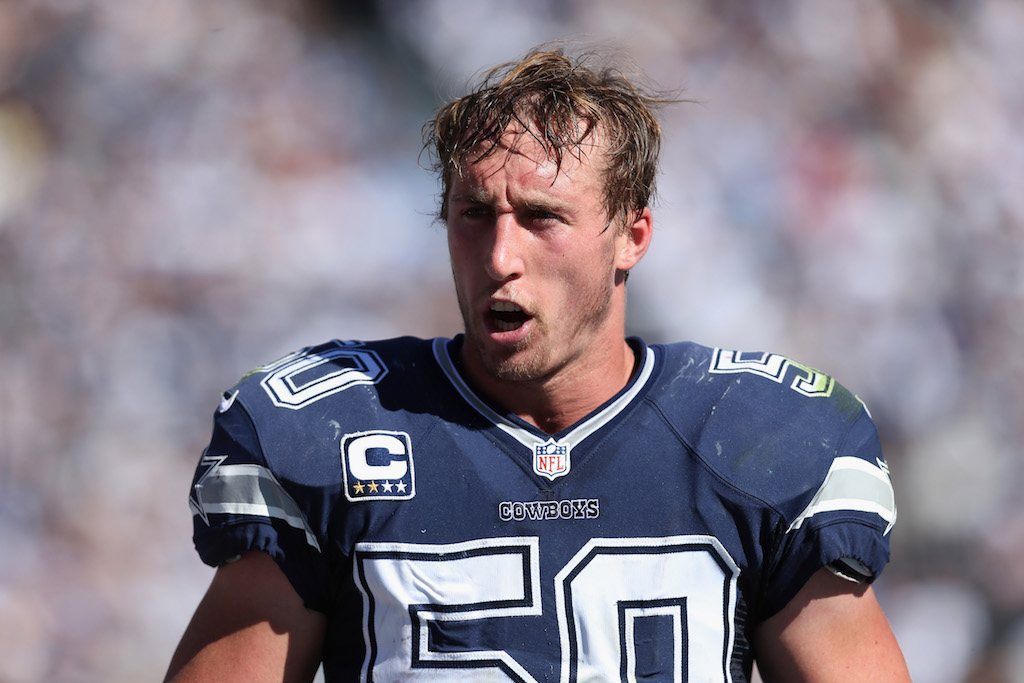Sean Lee talks to the defense between plays.