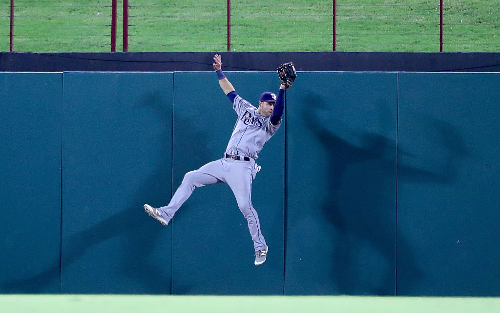 Kevin Kiermaier of the Tampa Bay Rays fields a fly ball hit.