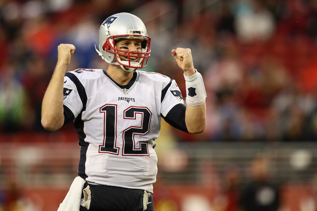 Tom Brady pumps his fist after throwing a touchdown pass.