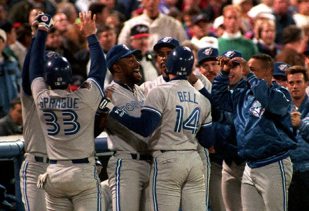 Toronto Blue Jays pinch hitter Ed Sprague (33) is congratulated