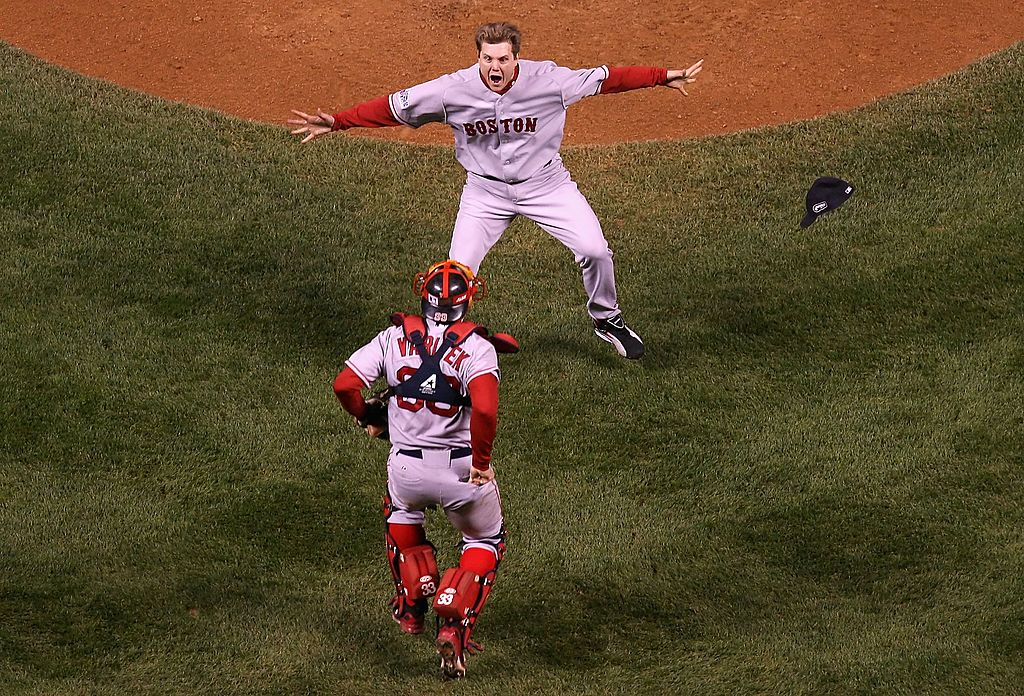 Relief pitcher Jonathan Papelbon #58 of the Boston Red Sox celebrates with Jason Varitek #33