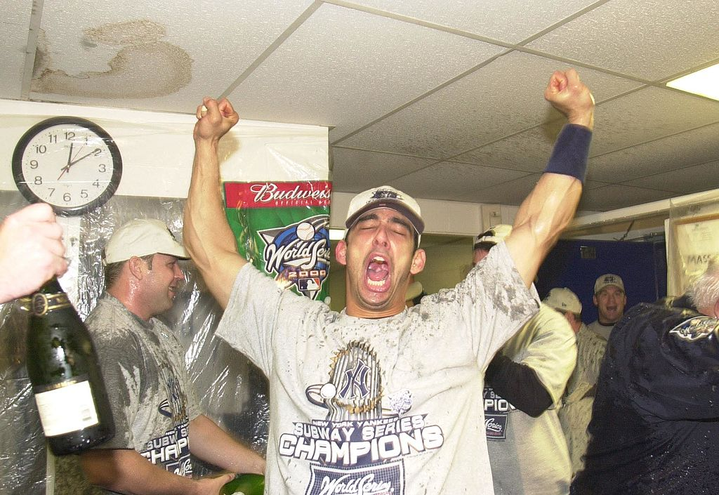Catcher Jorge Posada of the New York Yankees celebrates in the locker room