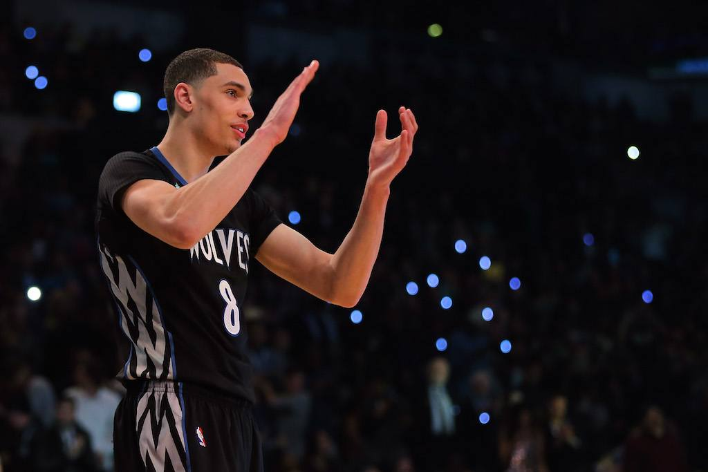 Zach LaVine claps from the sidelines during a game.