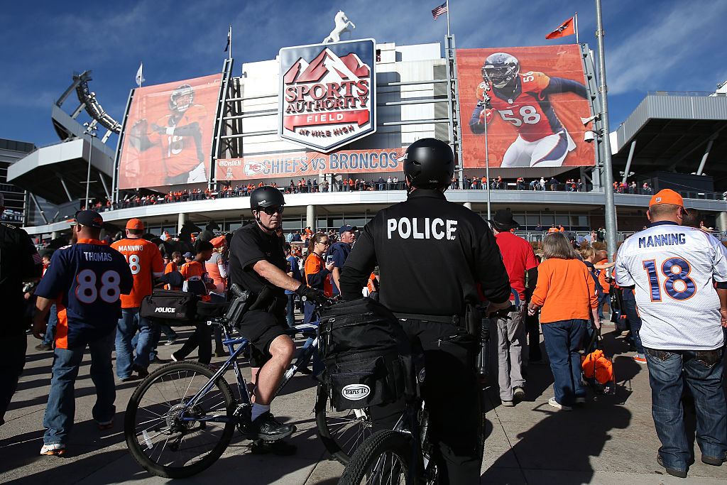 Police patrol Sports Authority Field before a Denver Broncos game.