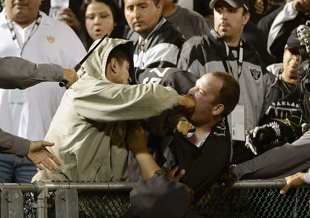 Two fans fight during a game between the San Diego Chargers and Oakland Raiders | Thearon W. Henderson/Getty Images